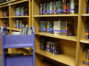 Science Fiction section with color-coded stickers, labels, bookends & bookcart